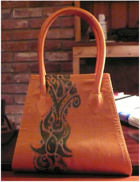Orange purse with doodle tattoo band