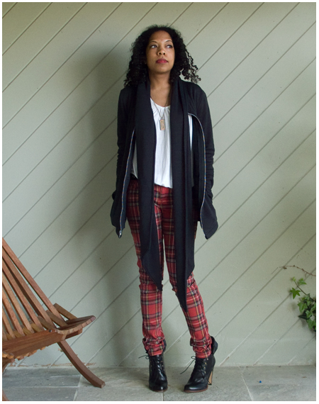 Red plain skinnies, white t-shirt, black jacket with scarf tails, black high heeled ankle boots