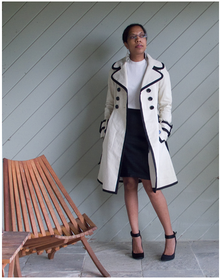Black strips striped leather skirt, cream cashmere t-shirt, black and white satin pumps, silver jewellery, black edged cream trench