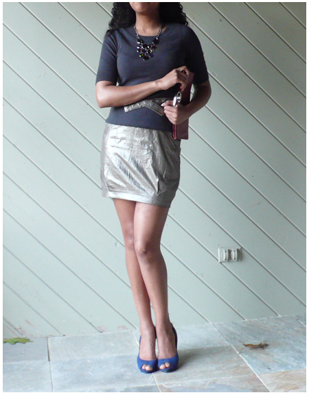Grey cashmere crew neck T, gold metallic skirt, blue peep toe pumps, gold plaid belt, red clutch, statement necklace