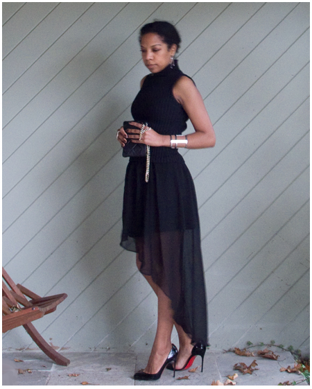 Black asymmetrical hem sheer skirt, black mock neck turtleneck, gold chain black purse, asymmetric black  heels, silver cutout cuff